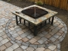 Paleo paver patio with outdoor fireplace, Seattle
