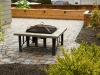 Paleo paver patio with outdoor fireplace and raised cedar bed - Seattle, Ecoyards.