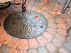 NW manhole feature in circular paver