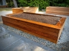 Raised planter bed with Ipe cladding.