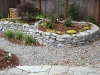 Raised landscape bed with new plantings