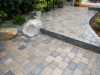 Roman cobblestone paver patio with boulder seating - West Seattle, Ecoyards.