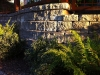 Roman Pisa retaining wall with landscape plantings - West Seattle, Ecoyards.