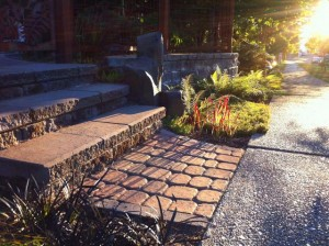 Steps and walls with tumbled retaining wall blocks